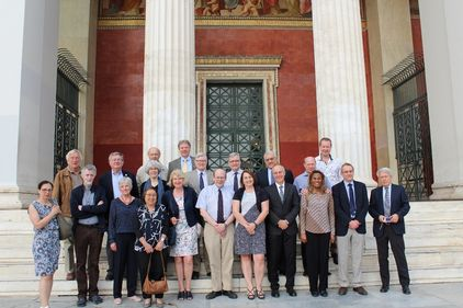 The members of the International Liver Study Group and their companions in front of the Propylaia at the Historical Central Building, NKUA.